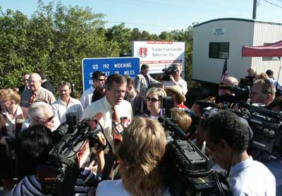Florida Governor Jeb Bush speaks to the news media at Ranger's US-192 /SR-500 project in Central Florida.
