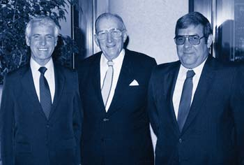 Mike Sherwood, Leo Vecellio, Sr., and Shelby Jarrell celebrate Mike's 50 years with V&G in 1996. Leo Vecellio, Sr., passed away later that year. Shelby reached the 50-year mark in 2006, while Gerald Cooper and Horace Bedford reached it this year. Richard Thiboult, a 2004 retiree, also achieved a half-century of service.