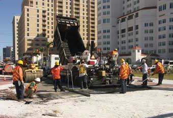 A Ranger paving crew works in downtown West Palm Beach, Florida.