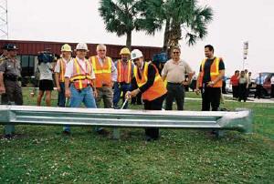 "Temporarily ""installing"" a ceremonial guardrail are, L tor R, Amy Butcher (Ranger), Greg Reilly (Ranger), Skip McMichael (KCCS), Kelvin Liss (Ranger), Rep. Irv Slosberg, Scott Woss (KCCS), and Edel Medina (KCCS)."