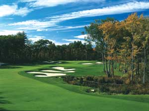 Hole 4 of the Tournament Players Club  (TPC) of Boston. The course blends in with the environmentally sensitive lands of Norton, MA.