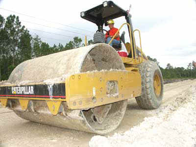A vibratory roller compacts road base material on Ranger North's SR-520 widening project in Orange County, FL.