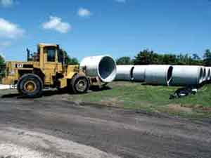 "James ""Lee"" Lucas runs a Loader to move segments of 72""drainage pipe at the Botanica site development project in Jupiter, Florida."
