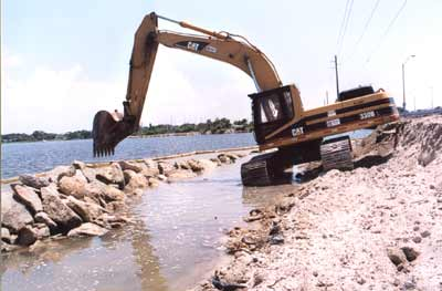 An impermeable barrier blocks silt run-off at Ranger's riprap job along SR-518 (Eau Gallie Causeway) in Melbourne. This is just one example of Ranger's ongoing commitment to environmentally responsible construction.