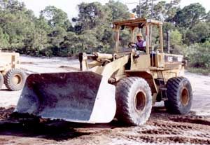 Robert Williams runs the loader during site preperation at Oleander Pines, just north of Port St. Lucie, Florida.