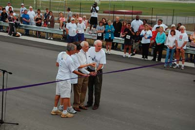 A ribbon-cutting ceremony marks the opening of a 2.7-mile, Ranger-built section of SR-414, shown in part below.