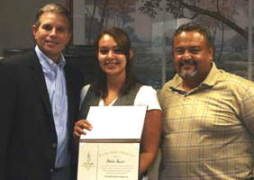Scholarship recipient Natasha Rosales and her father, Jose Rosales, right, with Hazen Hinds, left, President of Ranger Construction — South.