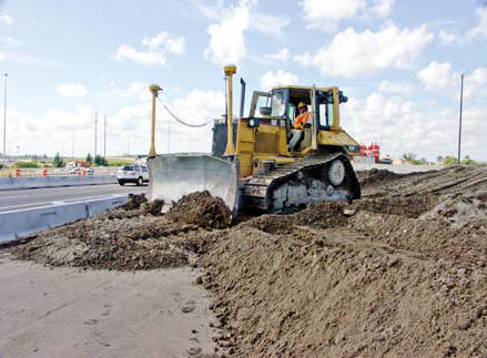 Above: Ranger employee Butch Sims operates a D6 dozer on an I-595 road construction and asphalt paving project in Ft. Lauderdale. The heavy equipment is fitted with GPS technology for fast, accurate grading results. (Photo by Carl Thiemann)