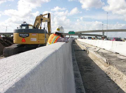Above: Foreman Bob Roche looks down a barrier wall as he takes a call on Ranger's portion of an extensive I-595 road construction and asphalt paving project underway in Ft. Lauderdale, FL. (Photo by Carl Thiemann)