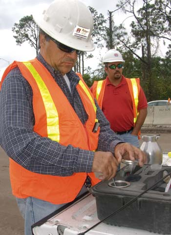Quality Control Technician Jaime Duarte conducts a test while Superintendent David Strickland looks on. (Photo by Carl Thiemann)