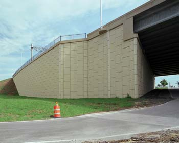 The attractive finished look of the RE wall (also referred to as mechanically stabilized earth (MSE) wall on this project) is shown near the Gas Line Bridge on Ranger's SR-414 project. (Photo by Leo Nelson)