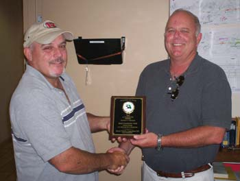 Dalton Rachal, left, and Sandy Daniels hold one of Ranger South's two recent awards.