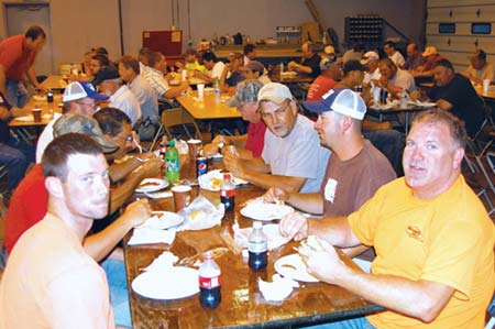 Enjoying a safety celebration at Sharpe Bros. are, in the foreground on the left, John Paul Evans and, on the right, Rod Powell, Ricky Saunders and Tim Bailey. (Photo by John Riley, Jr.)