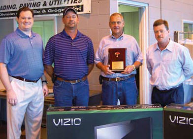 Travelers' Steve Beals, right, presents a plaque honoring Sharpe Bros.' safety record to Vecellio Group V.P. Michael Vecellio, left, Sharpe Bros. Field Safety Manager John Riley, Jr., and Sharpe V.P. Ivan Clayton.  (Photo by Gloria Fields)