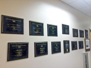 a wall showing many award plaques earned by Ranger Construction Industries Inc.